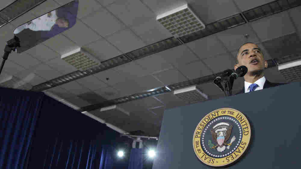 When he addresses crowds, the president often uses a teleprompter (screen at left) and a podium adorned with the presidential seal. Here: an Aug. 5, 2011, event at the Washington Navy Yard.