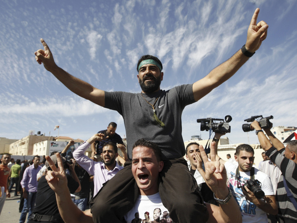 Palestinians celebrate the release of prisoners in the West Bank city of Ramallah. A total of 477 Palestinians were freed Tuesday, with 550 more slated to be released in two months.