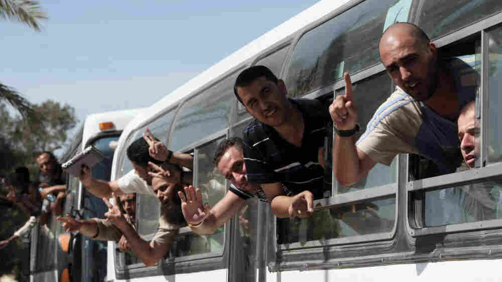 Palestinian prisoners cross to the southern Gaza Strip from the Egyptian side of the Rafah border earlier today (Oct. 18, 2011) following their release from Israeli prisons.