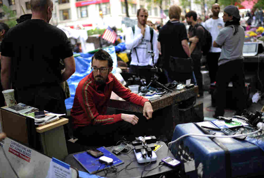 Occupy Wall Street volunteers man a communication station in Zuccotti Park near Wall Street on Oct. 11. The media team monitors Twitter and Facebook and oversees the group's Livestream feed.