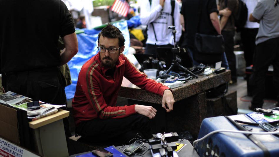 <p>Occupy Wall Street volunteers man a communication station in Zuccotti Park near Wall Street on Oct. 11. The media team monitors Twitter and Facebook and oversees the group's Livestream feed.</p>