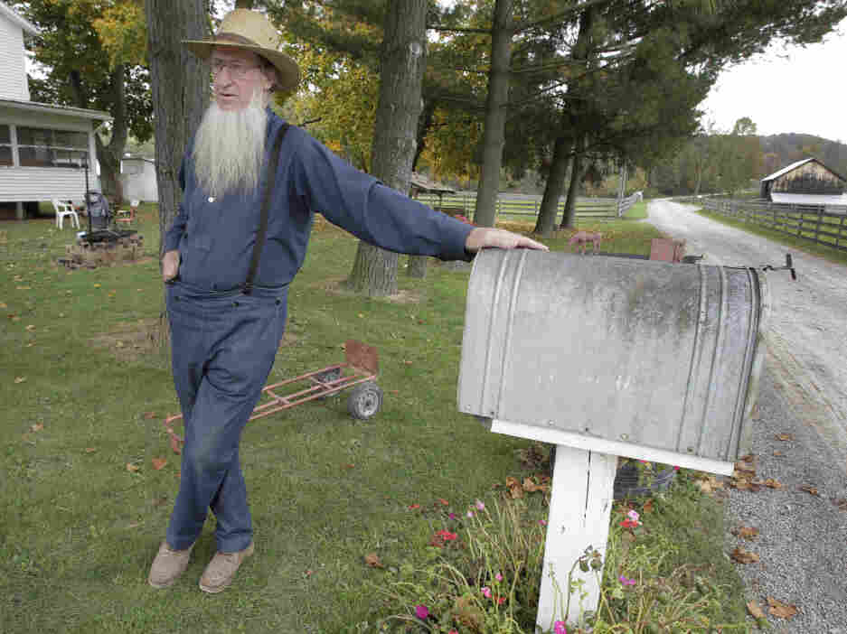 Sam Mullet, father of two of the three men arrested for allegedly going into the home of other Amish and cutting their hair and beards, is seen outside his home in Bergholz, Ohio. Some who have left Mullet's community have accused him of abuse.