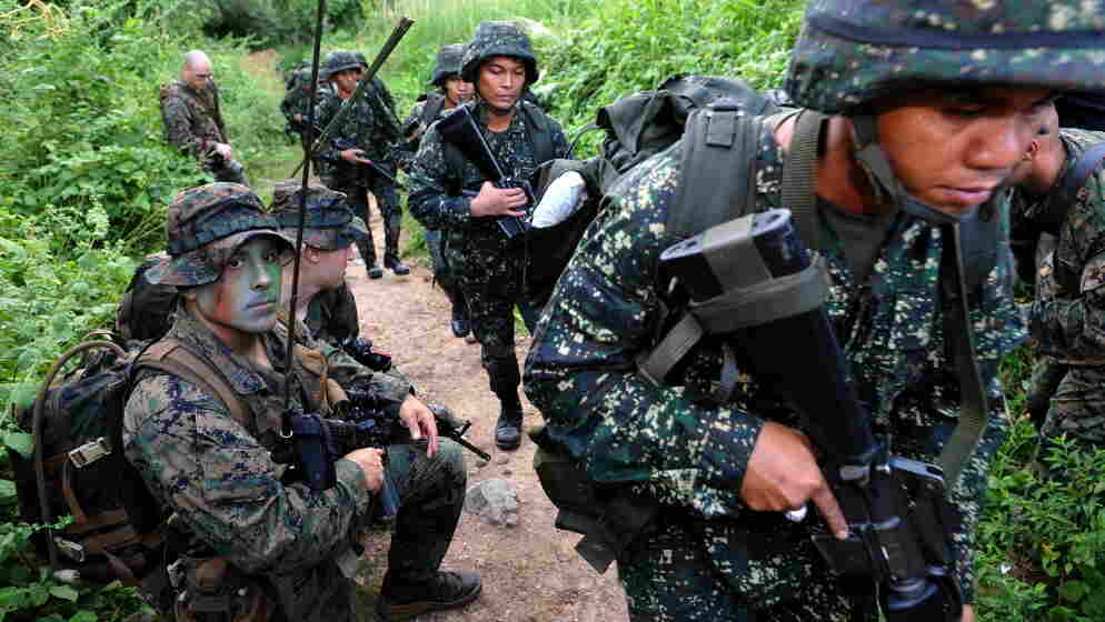 U.S. Marines and their Filipino counterparts take part in a training exercise last year in the Philippines. The U.S. has a history of sending small military contingents abroad.