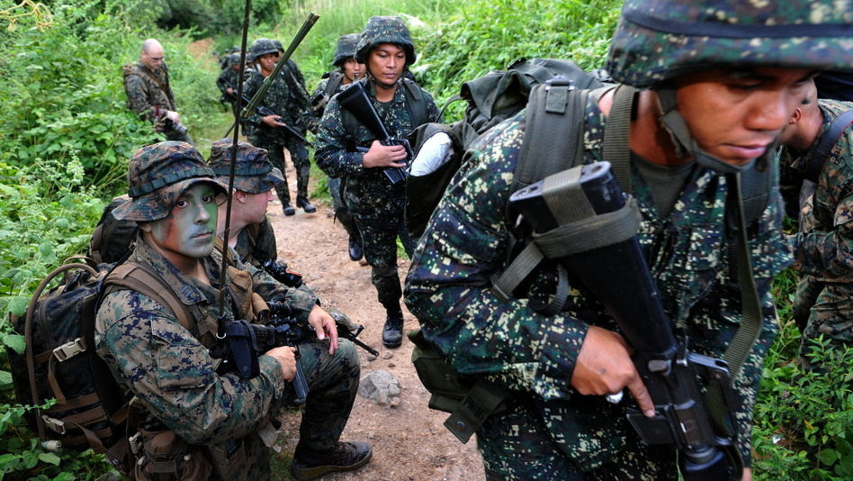 U.S. Marines and their Filipino counterparts take part in a training exercise last year in the Philippines. The U.S. has a history of sending small military contingents abroad. (AFP/Getty Images)