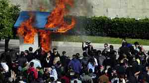 Outside the Greek parliament building today, protesters burned a guard box.