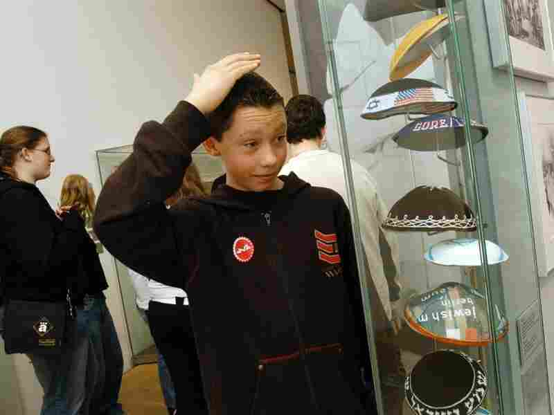 A young visitor explores the Kippot cabinet. In the last 10 years, the museum has hosted over 60 exhibitions and hundreds of events.