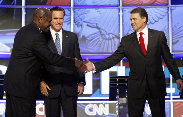 """Brother"" Herman Cain shakes hands with Texas Gov. Rick Perry, Tuesday, Oct. 18, 2011."
