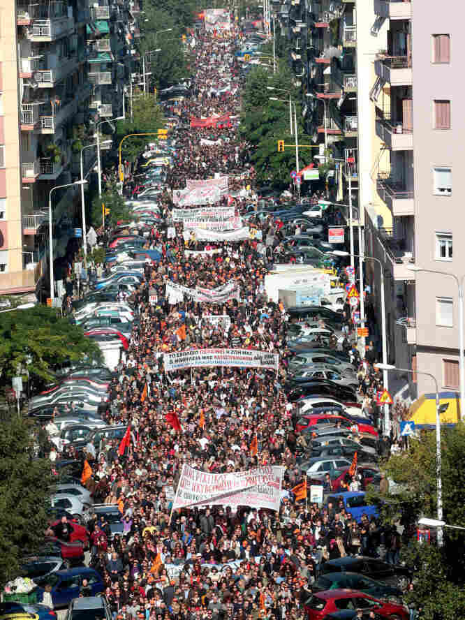 Thousands of people massed in Thessaloniki to rail against proposed legislation that includes fresh tax increases as well as yet more wage, pension and job cuts. Parliament was expected to vote on the bill Thursday.