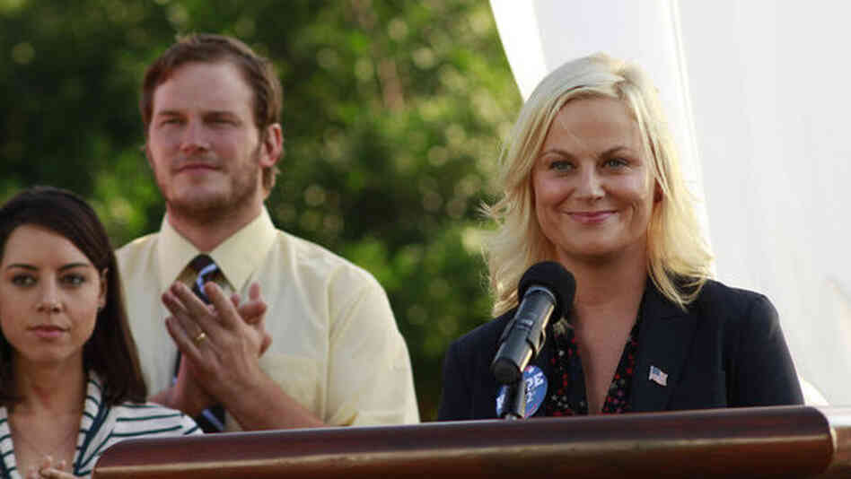 Amy Poehler, seen here with Aubrey Plaza as April Ludgate and Chris Pratt as Andy Dwyer, plays idealistic bureaucrat Leslie Knope on NBC's Parks And Recreation.