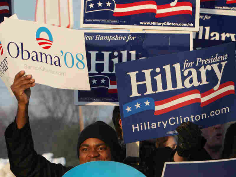 In 2008, the primary battle between then-Sens. Barack Obama and Hillary Clinton dragged on for months. Above, supporters of Obama and Clinton hold signs outside a polling place in January 2008 in Nashua, N.H.