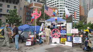 Occupy Boston protesters congregate across the street from the Federal Reserve Bank of Boston.