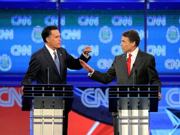 Mitt Romney and Texas Gov. Rick Perry clash at Republican presidential debate, Oct. 18, 2011 in Las Vegas, Nv.