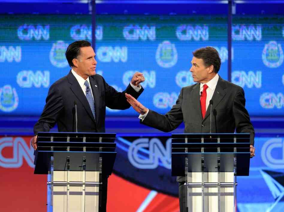 Mitt Romney and Texas Gov. Rick Perry clash at Republican presidential debate, Oct. 18, 2011 in Las Vegas, Nv.