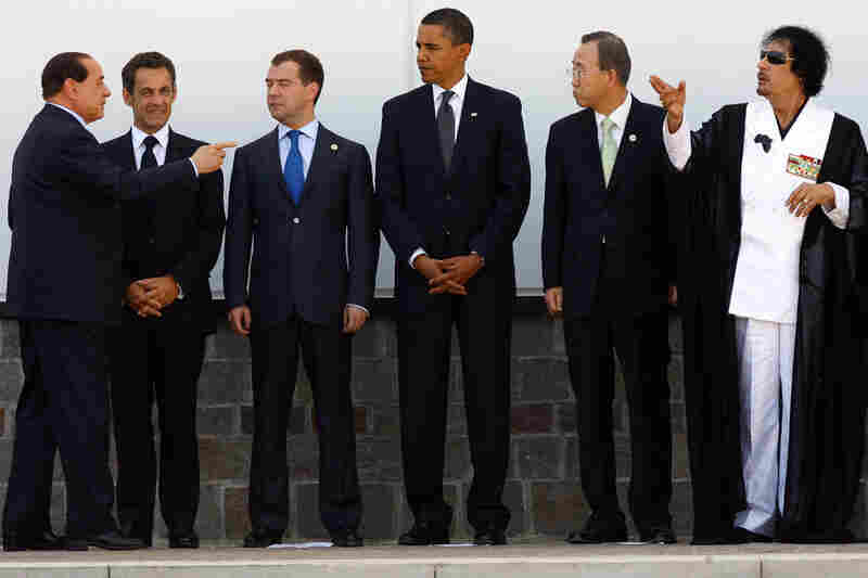 2009: Gadhafi poses with (from left) Italy's Silvio Berlusconi, France's Nicolas Sarkozy, Russia's Dmitry Medvedev, Barack Obama of the United States and United Nations Secretary-General Ban Ki-moon during a G8 summit in Italy.