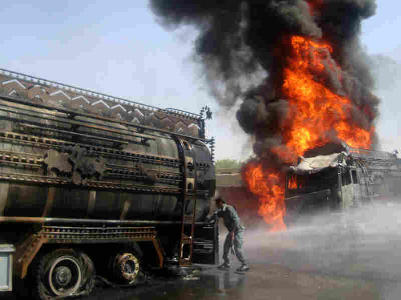 A tanker bringing fuel to U.S. and NATO forces burns after being attacked by militants in Afghanistan's Logar province in August. Military officials say fuel convoys are a significant vulnerability for U.S. forces.