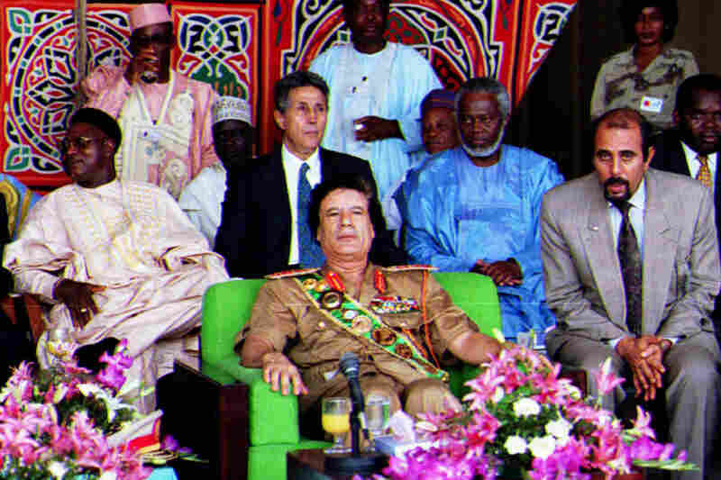 1996: Surrounded by guests and aides in Tripoli, Gadhafi marks the anniversary of the 1969 coup that brought him to power.