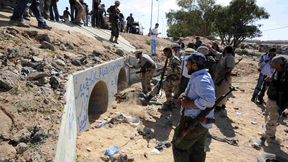 Libyan Transitional National Council fighters said Moammar Gadhafi was captured Thursday in this graffitti-filled culvert in Sirte.