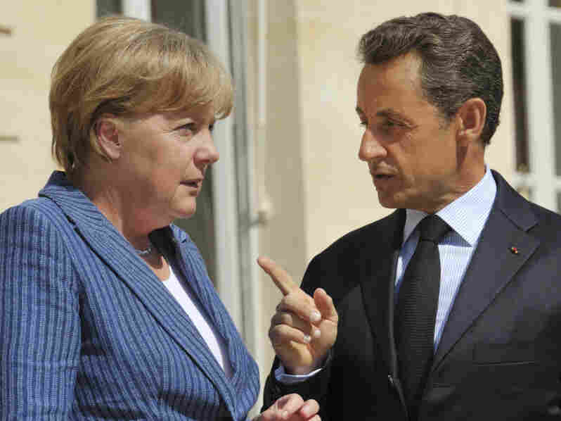 France's President Nicolas Sarkozy, right, speaks to German Chancellor Angela Merkel.