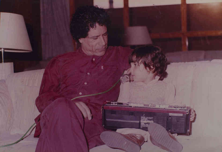Moammar Gadhafi plays with his daughter.