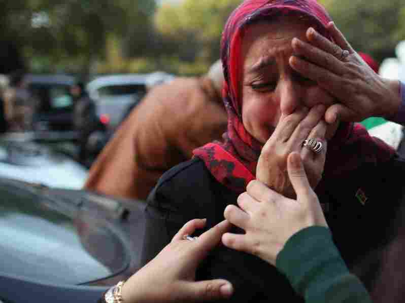 A woman is overcome with emotion during celebrations outside the Libyan Embassy in London on Thursday, after the news that former Libyan leader Col. Moammar Gadhafi was killed after an assault on his hometown of Sirte.