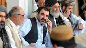 The assassination of Ahmed Wali Karzai (center, shown in 2009), the half-brother of Afghan President Hamid Karzai, prompted fears of a security breakdown in the southern Afghan city of Kandahar. Ahmed Wali Karzai was rumored to have a hand in everything that went on in the region: tribal affairs, politics and business.