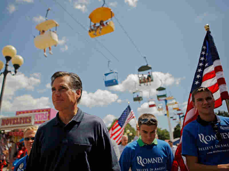 Mitt Romney, shown here at the Iowa State Fair in August, was back in the state on Thursday — his first visit since summer. At one point during his town hall on Thursday, he was asked why he has spent so little time in the state.