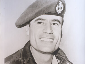 A young Moammar Gadhafi smiles in an undated family photograph.