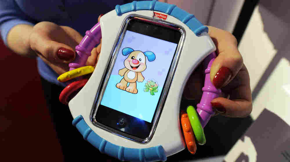 For real: Fisher-Price's Laugh & Learn Baby iCan Play Case protects an iPhone while baby plays with apps.