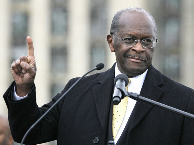 "Republican presidential candidate Herman Cain speaks on Friday while unveiling his ""Opportunity Zone"" economic plan in front of the Michigan Central Statio"