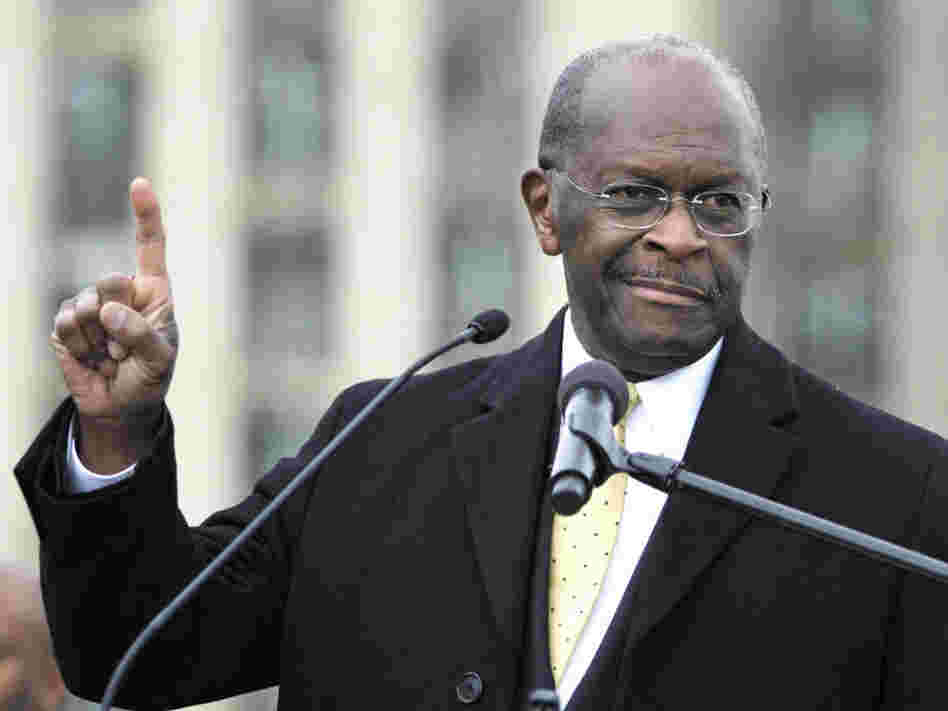 "Republican presidential candidate Herman Cain speaks on Friday while unveiling his ""Opportunity Zone"" economic plan in front of the Michigan Central Station, an abandoned train depot in Detroit."
