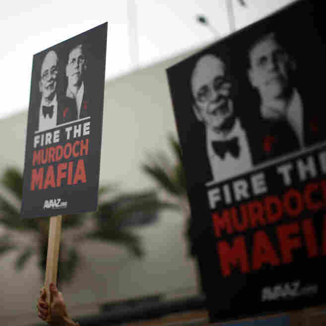 Protesters demonstrate outside the News Corp. annual shareholder meeting at Fox Studios in Los Angeles on Friday.