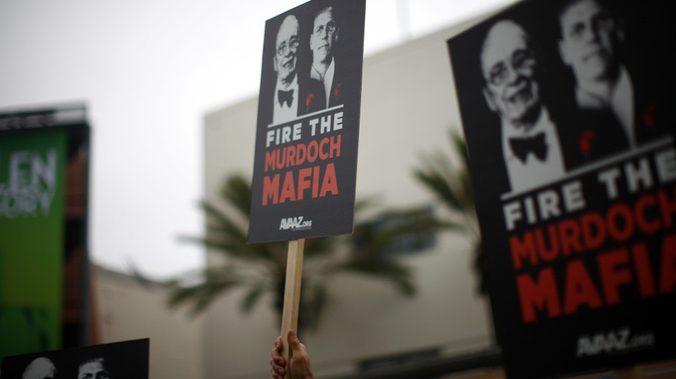 Protesters demonstrate outside the News Corp. annual shareholder meeting at Fox Studios in Los Angeles on Friday.  (Getty Images)