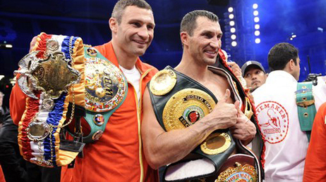 Vitali (left) and Wladimir (right) Klitschko pose together after Wladimir's victory over David Haye in July 2011 to win the WBA heavyweight title.