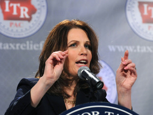 Rep. Michele Bachmann, shown speaking at a reception by the anti-tax group Iowans for Tax Relief, was once a prosecutor for the IRS. On the campaign trail, she has made that part of her resume a selling point.