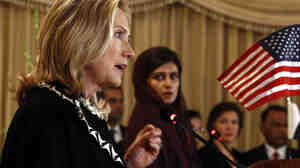 Secretary of State Hillary Clinton speaks in Islamabad Friday, as Pakistan Foreign Minister Hina Rabbani Khar looks on. Clinton urged Pakistan to act swiftly to dislodge the militant Haqqani network.