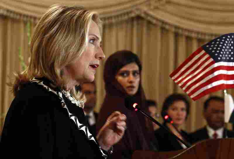 U.S. Secretary of State Hillary Clinton addresses a joint press conference in Islamabad on Friday, as Pakistan's Foreign Minister Hina Rabbani Khar looks on.