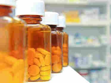A row of pill bottles