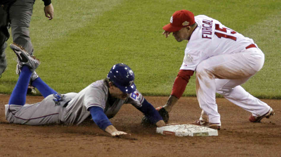 The Rangers' Ian Kinsler steals second in the ninth inning, barely beating the tag by the Cardinals' Rafael Furcal. The steal sparked a game-winning rally for Texas.