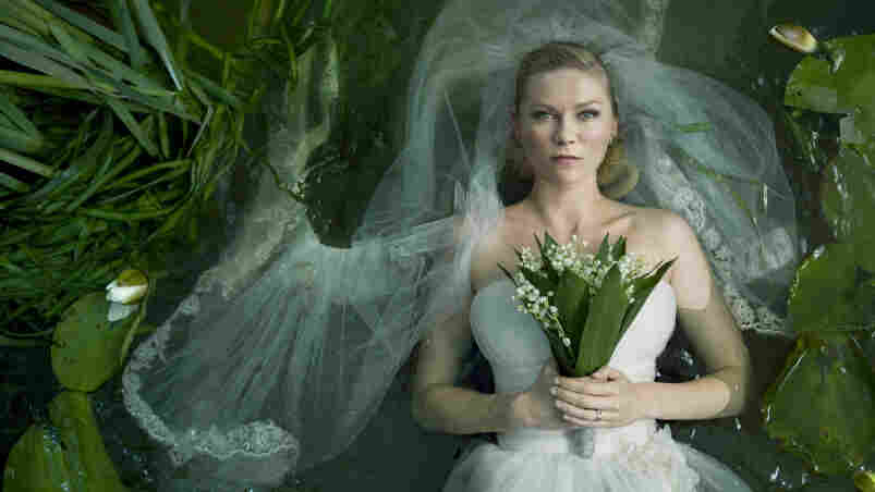 Here Bums The Bride: Lars von Trier's Melancholia centers on a newlywed (Kirsten Dunst) whose chronic depression leaves her singularly well-equipped to confront the end of the world.