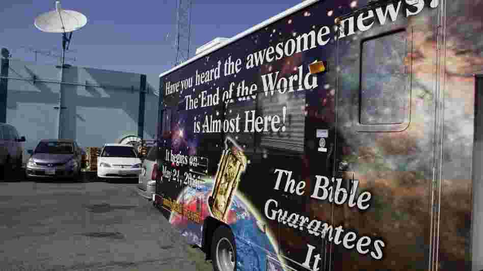 A sign on an RV announces the end of the world, outside Harold Camping's ministry in Oakland, Calif., Monday, May 23, 2011. Ahead of that day, many of Camping's followers had quit their jobs or donated money to pay for more than 5,000 billboards and 20 RVs plastered with the Judgment Day message.