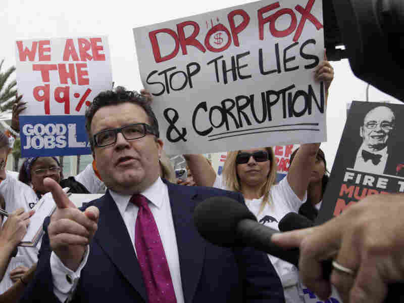 British lawmaker Tom Watson, who is leading the investigative charge into the News Corp. hacking scandal, talks to protesters outside Fox Studios.