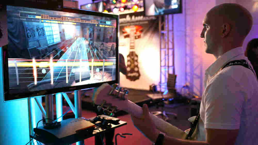 Paul Cross, creative director of Rocksmith, plays the game at a demonstration event in San Francisco, Calif.