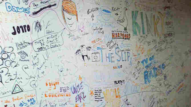 The famed World Cafe signature wall, where every guest leaves a mark on the studio. Spot anyone you recognize?