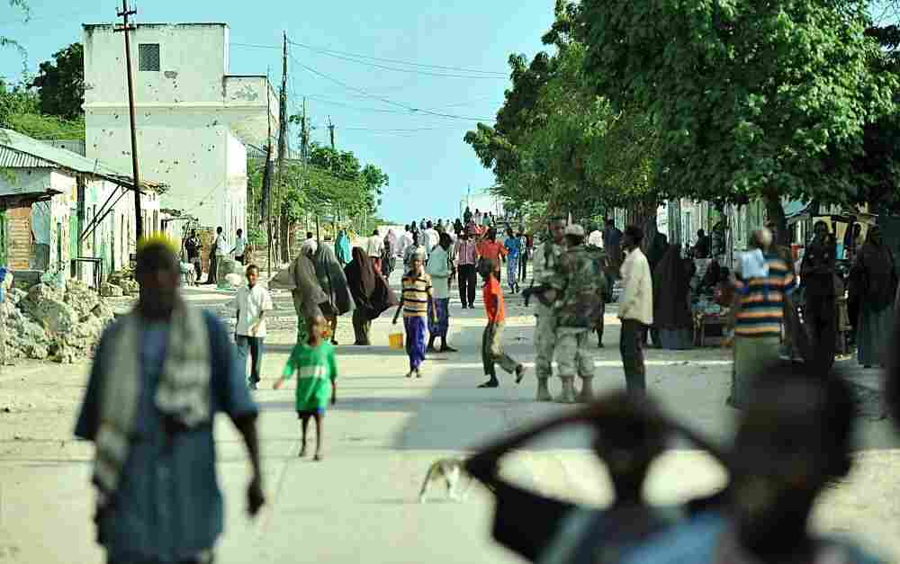 Residents walk along a busy street in Somalia's capital, Mogadishu, on Oct. 6. After four years of bitter battles, African Union-backed government troops forced the militant group al-Shabab to pull out of the city.