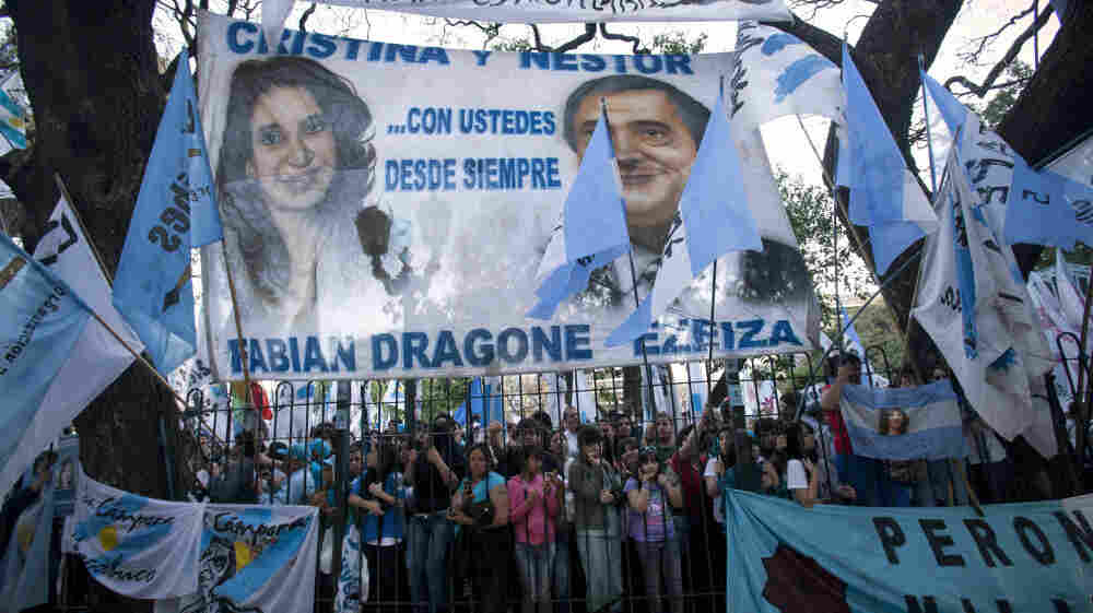 Images of Argentina's President Cristina Fernandez and her late husband, former President Nestor Kirchner, loom over supporters at a campaign rally in Buenos Aires on Wednesday.