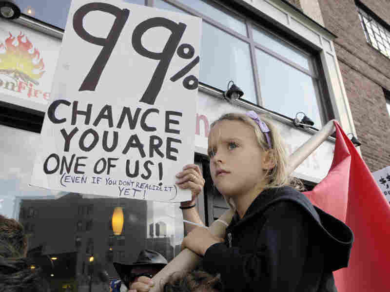 Luoisiana Harris, 7, marches with Occupy Wall Street protesters from their base in Zuccotti Park toward Washington Square last Saturday. Harvard professor Lawrence Lessig says the Occupy Wall Street movement and the Tea Party share some similar concerns.