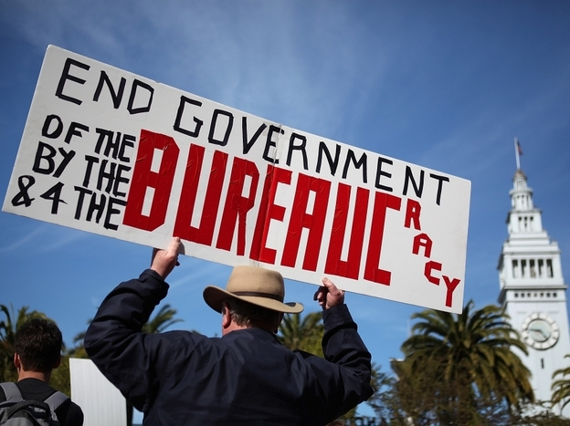 <p>An activist holds a sign during a tax day Tea Party rally in San Francisco.</p>