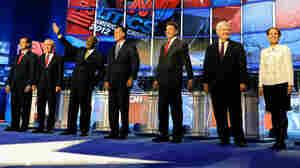 Former U.S. Sen. Rick Santorum, U.S. Rep. Ron Paul, businessman Herman Cain, former Massachusetts Gov. Mitt Romney, Texas Gov. Rick Perry, Former House Speaker Newt Gingrich and U.S. Rep. Michele Bachmann participate in a Re