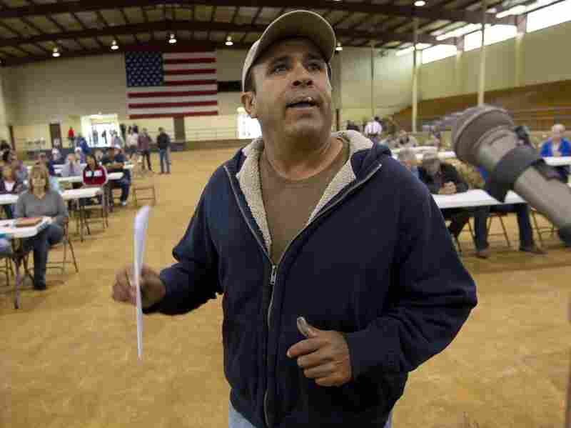 Migrant worker Felipe Chacoa of Mexico talks about his desire to continue to harvest produce during a meeting of farmers and state officials to discuss the impact of the Alabama Immigration law on their livelihoods in Oneonta, Ala.