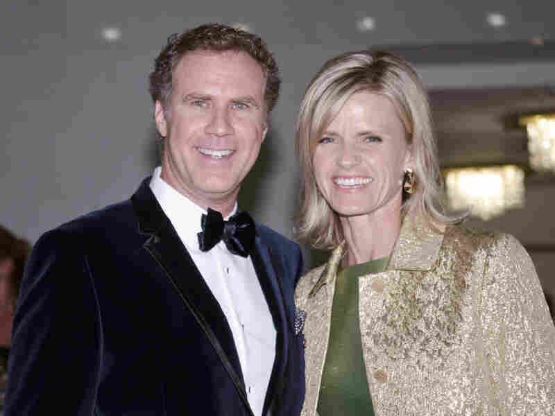 Will Ferrell and Viveca Paulin pose for photos on the red carpet during the 14th Annual Mark Twain Prize for American Humor at the John F. Kennedy Center for the Performing Arts on Sunday.